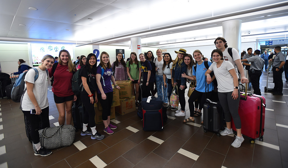 Catholic University students gathered at the airport ready to fly to Puerto Rico